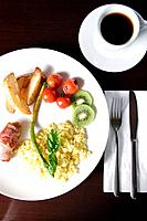 Potato, sausage, omelete, vegetables with coffee