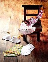 Female underwear bras and panties on the chair and floor