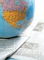 Globe on newspaper