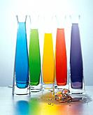 Colourful liquid in glasses