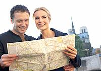 Couple outdoors with map smiling (thumbnail)
