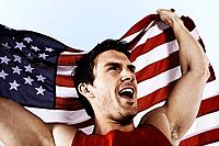 Athlete with American flag smiling and proud
