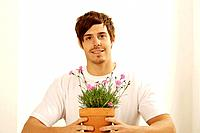 Man posing with a potted flower
