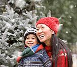 Asian mother and son in snow