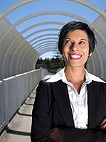 Mixed Race businesswoman with arms crossed (thumbnail)