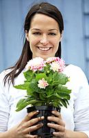 Woman with potted flower