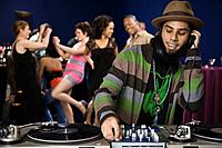 African male dj playing music