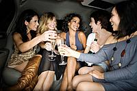 Multi_ethnic women toasting with champagne