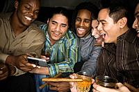 Multi_ethnic men celebrating in limousine