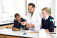 Students and teacher in science laboratory