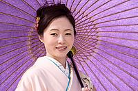 Asian woman holding parasol