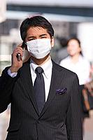 Asian businessman wearing surgical mask