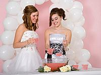 Multi_ethnic girls drinking punch at prom