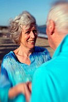 Closeup of senior couple on the beach