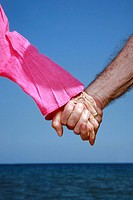 Closeup of senior couple holding hands