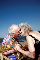Senior couple with on beach kissing