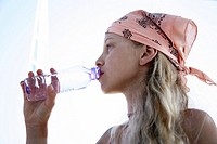 Girl drinking water from a bottle