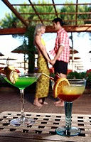 Cocktails with mature adult couple in background