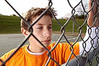 Boy hanging out at basketball court