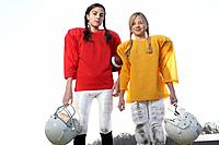 Girls dressed in football uniforms