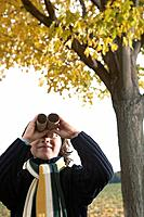 Girl looking through paper tube binoculars