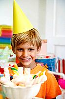 Boy wearing party hat