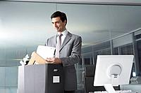 Businessman with box of office belongings