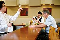 Bartender examining wine glass