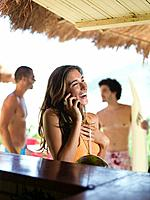 Woman talking on cell phone in bar