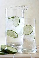 Pitcher with ice water and cucumber slices