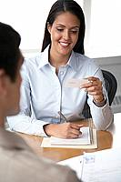 Businesswoman looking at business card