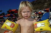 Gran Canaria, angry girl on holiday in Puerto de Mogan