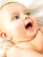 Baby lying down with mouth open