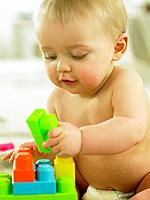 Baby playing with plastic blocks