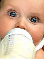 Baby's face close up with baby bottle (thumbnail)