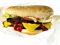 One Beef burger with toppings in take out packaging (thumbnail)