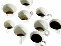 Nine Coffee Cups with and without coffee in them