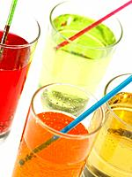 Four Glasses of fizzy drinks with straws