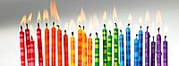 Colourful Candles lit up in a row (thumbnail)