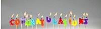 Candle Letters lit up and spelling out congratulations