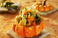 Avocado and pumpkin salad in hollowed_out pumpkin