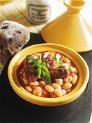 Tomato and bean stew with sausages in a tajine