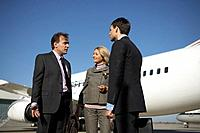 Businesspeople talking on airport runway