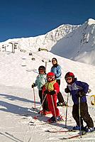 Young children downhill skiing w/parent @ Alyeska Ski Resort Girdwood Alaska Southcentral Winter