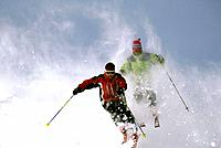 Downhill Skiers in loose snow Big Sky Resort Montana winter