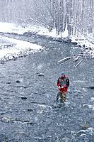 Flyfisherman Fishing in Spring Snowstorm Alaska