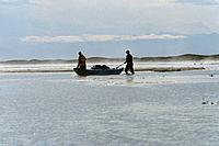 People Drag Raft Through Shallows Hulahula River AK AR Summer Misty Morning