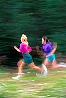Jogging on Coastal Trail Anchorage Southcentral AK/nBlur Summer Women