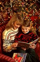 Woman Son Christmas Tree Ornaments Lights Reading Books Portrait Smiles Faces