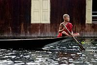 Young buddhist monk on his dugout, Inle lake, Myanmar